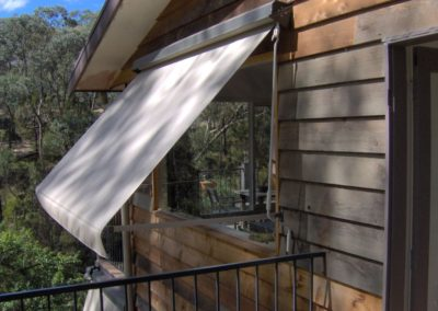 white pivot arm awning
