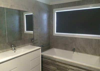 Black roller blinds in bathroom