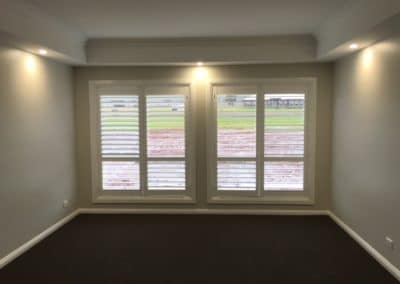 Double plantation shutters on 2 windows