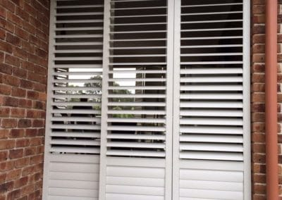 White stackable plantations shutters