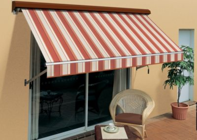 External straight drop awning over roller doors