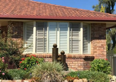 Basswood Plantation Shutters in Bay Window